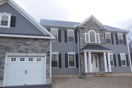 cultured stone on front entry bump-out